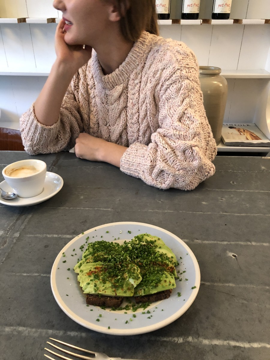 Engrossed in conversation, uncharacteristically ignoring a perfect serving of avocado toast