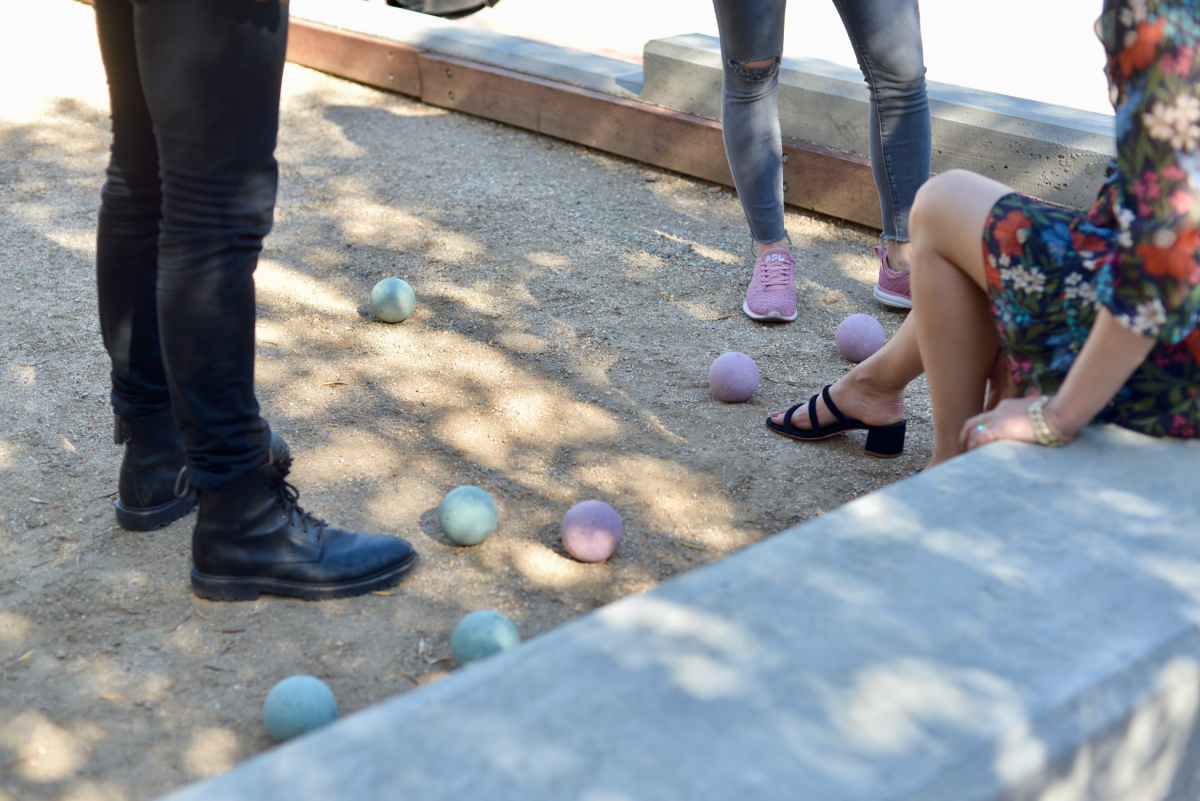 Setting up our next shot at a bocce ball court (Note: We had to look up photos to learn how to play...)