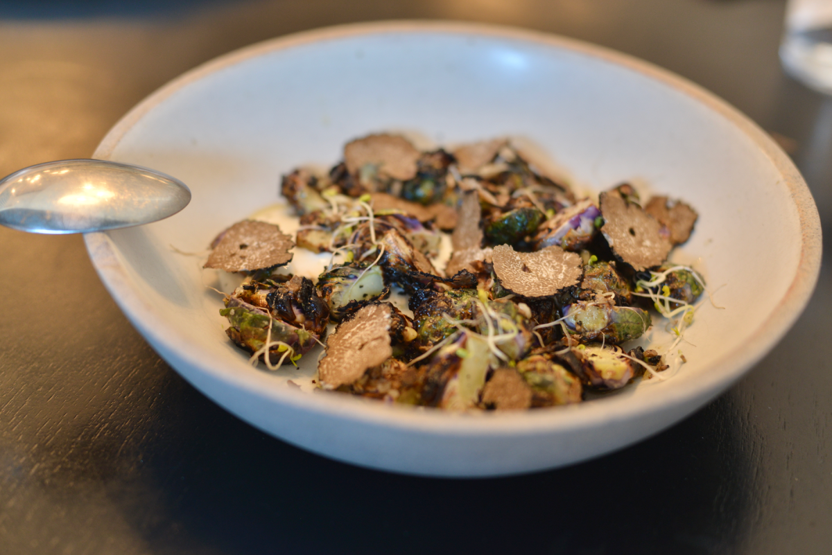 {The most amazing Brussels sprouts with truffles at a team lunch at Pizzana}