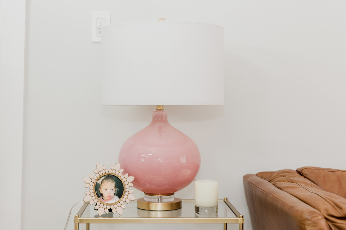 {Pink lamp on pink frame (this frame is a best-seller in the Shop!) in our living room}