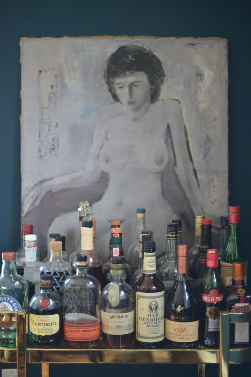 {A new vintage painting that sits atop our bar cart}