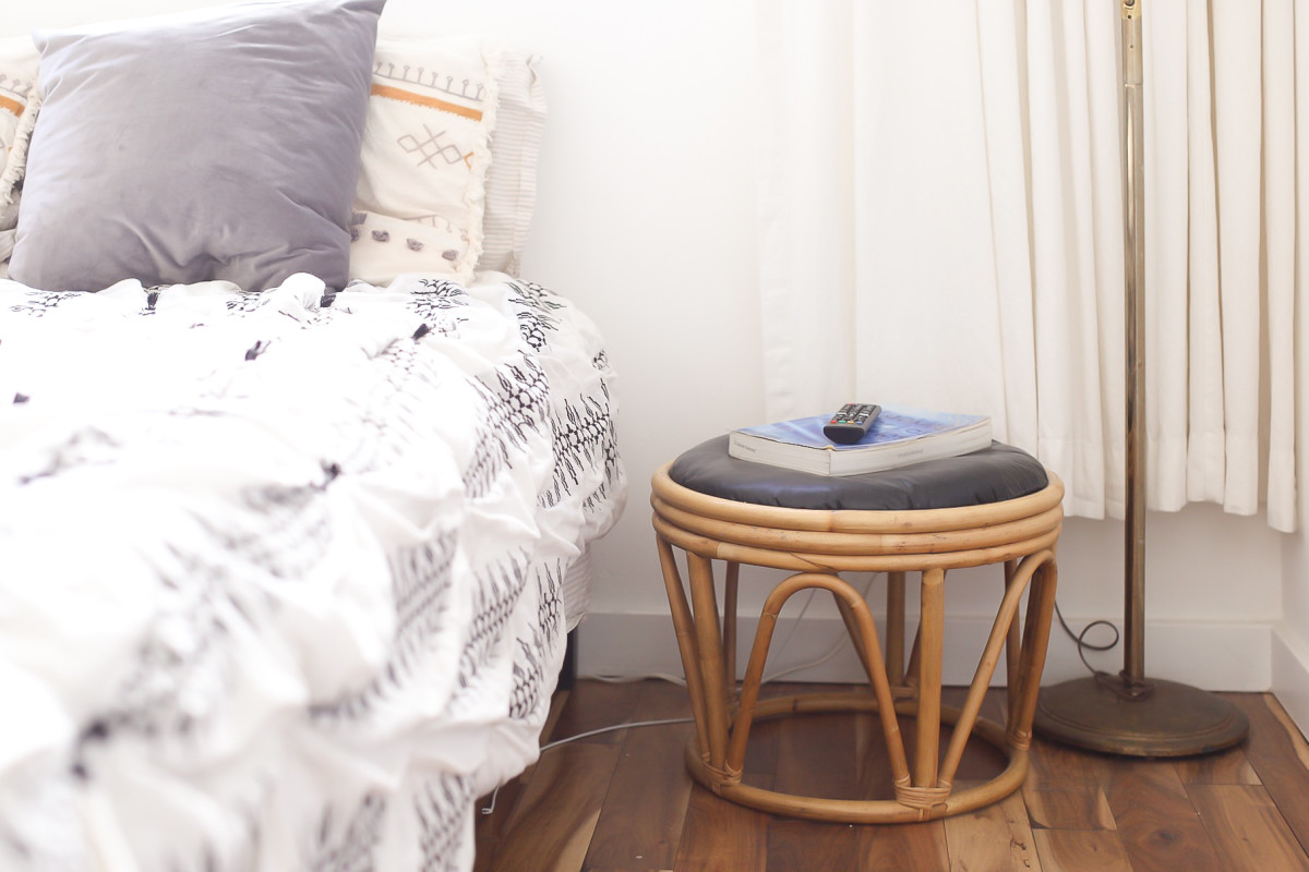 Old rattan foot stools are now used as my nightstands.