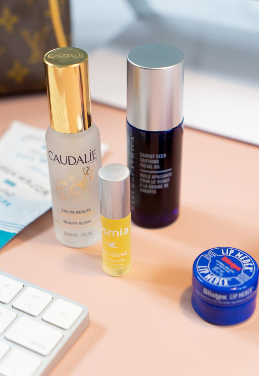 Caudalie Beauty Elixir, Osmia Blemish Oil, Naturopathica Carrot Seed Facial Oil, Blistex Medex