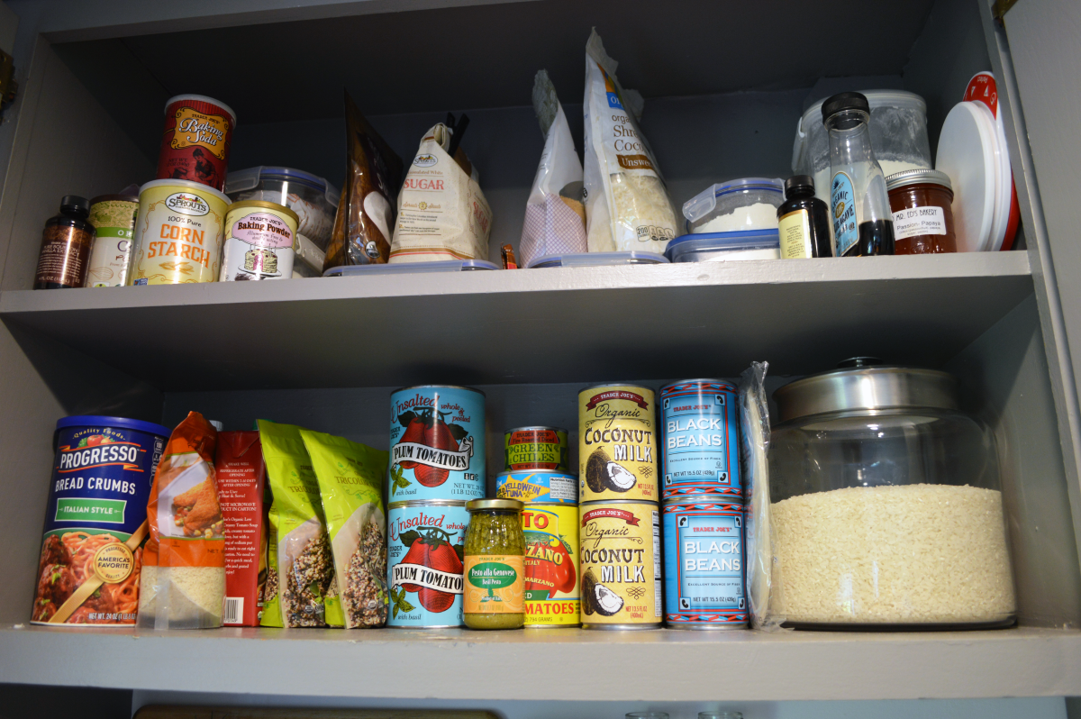 Our pantry cabinet, organized by baking on top and cans and grains on bottom!