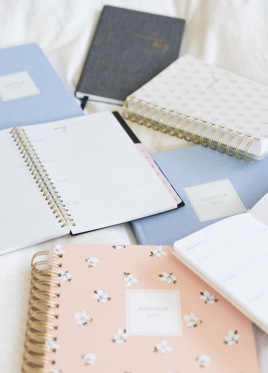 From left to right: Light Blue Fabric, Black Fabric, Poppy, Spiral-Bound Black Leather (In-Store Only), Light Blue Fabric, Ditsy Floral, Natural Fabric