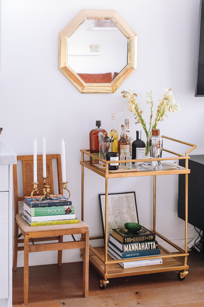 Target bar cart, vintage map of New York City, vintage candelabra. Byredo candle, CB2 pitcher vase, Jonathan Adler coasters, vintage mirror, vintage folding chair