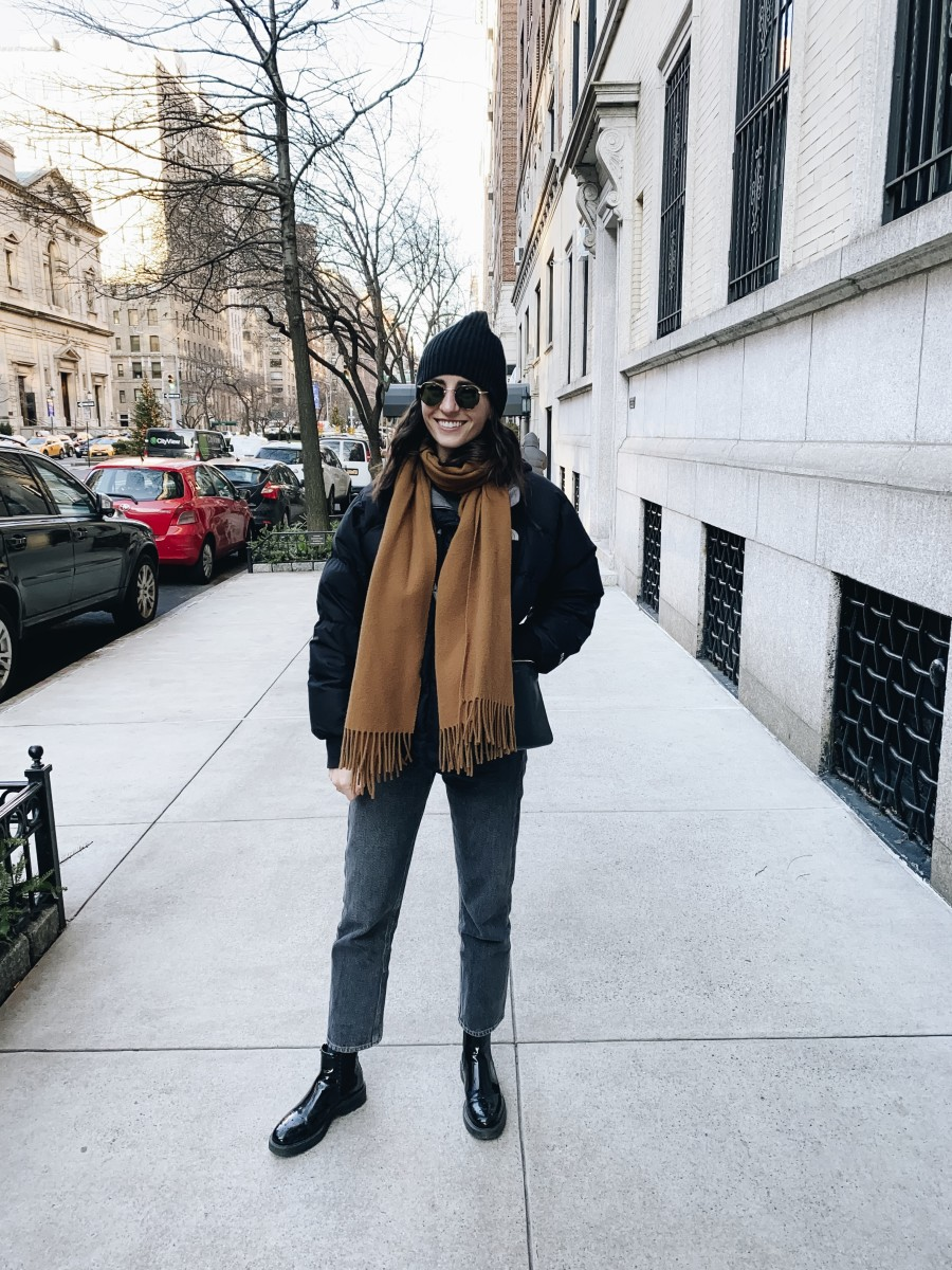 North Face Jacket (similar version on sale here), Éditions MR Scarf (similar here), Vince Sweater, AGOLDE Grey Jeans, Celine Purse, Prada Boots (similar here), Garrett Leight Sunglasses, Club Monaco Beanie