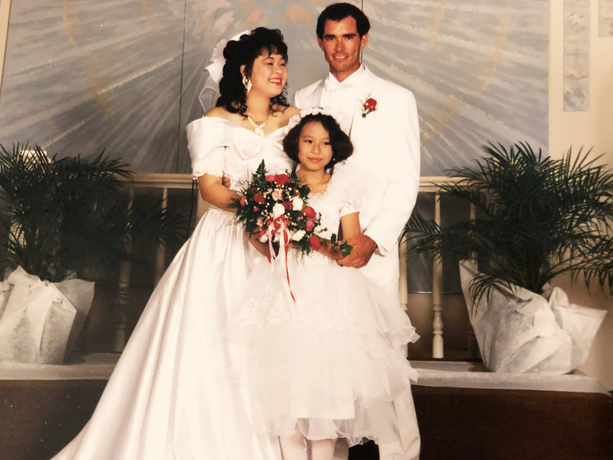 My mom, her husband, and me on their wedding day