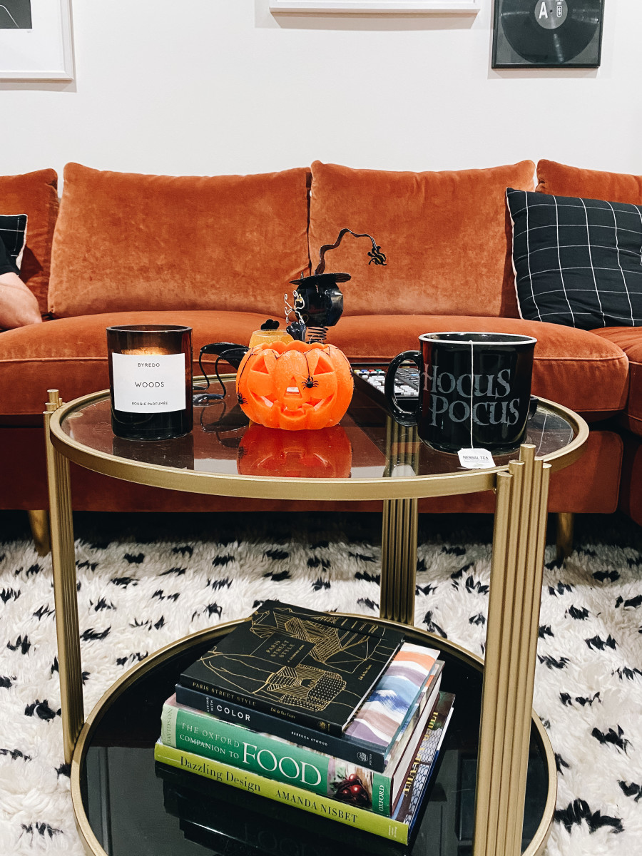 My current coffee table, adorned with my parents' old school Halloween decorations, and my Hocus Pocus mug.