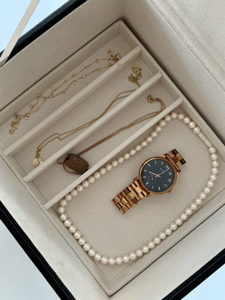 Left to right: Necklace from the Shop (no longer available), Sunburst necklace, gold chain with ancient bead passed down from my mom, string of pearls I'm planning on re-stringing into a necklace, the Marc Jacobs watch we all bought in 2012 ;)