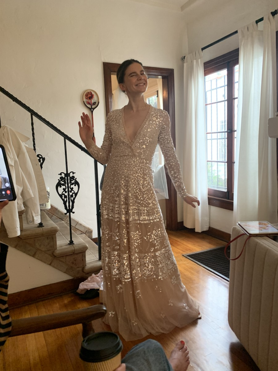 A photo taken by a friend during my dress try-on brunch! (Don't mind the foot or facetime happening)