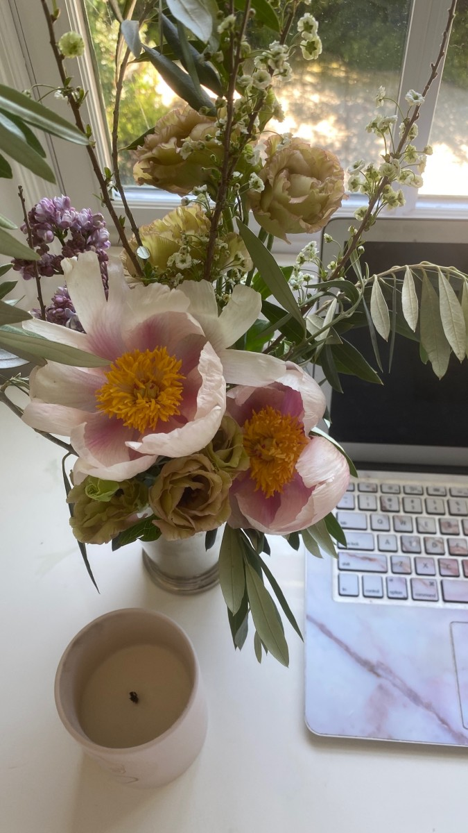 The prettiest bouquet and a candle sample at my desk.