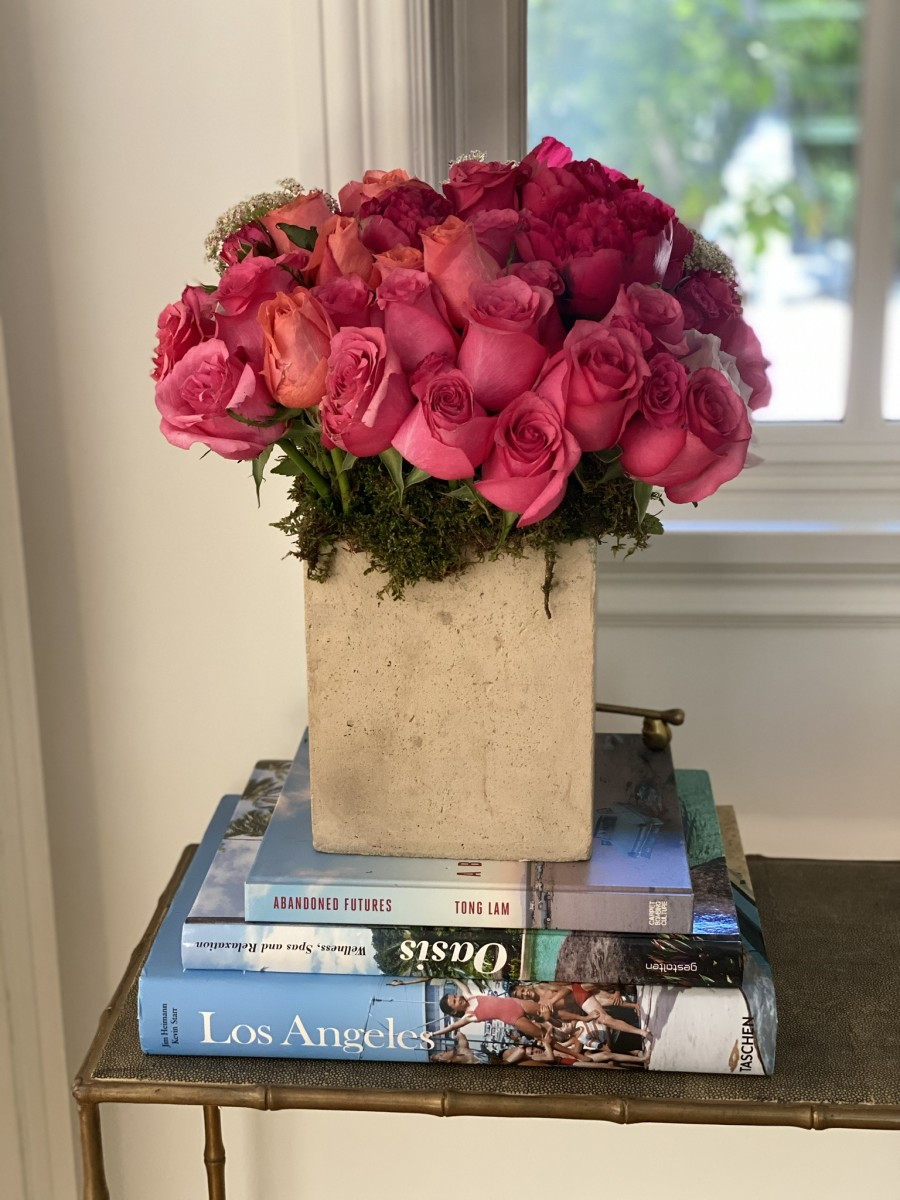 Birthday roses and a collection of coffee table books in our living room.