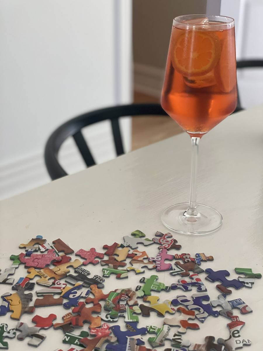 Aperol Spritz and an unfinished puzzle.